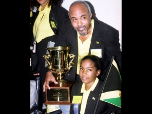 Spelling bee coach Rev. Glen Archer returns to Jamaica with Jodi-Anne Maxwell of Ardenne High School - the only Jamaican to have won the Scripps Howard National Spelling Bee in the U.S. in 1998.