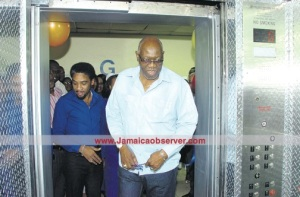 Hooray! An elevator that works! Minister Ferguson is gratified. (Photo: Jamaica Observer)