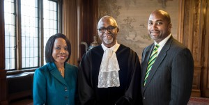 Following his Friday, February 6 swearing in as judge of the International Court of Justice in the Hague, Jamaican jurist, Patrick Robinson is flanked by Her Excellency, Vilma McNish, Ambassador of Jamaica to Belgium and his son the Hon. Julian Robinson, State Minister in the Ministry of  Science, Technology, Energy and Mining. (Photo: Ministry of Foreign Affairs/Foreign Trade)