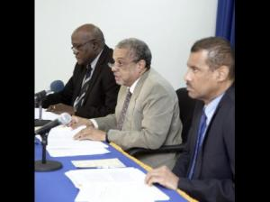 Looking a tad gloomy: James Stewart (left) director, Economic Planning, Research and Policy Logistics Division at the Planning Institute of Jamaica (PIOJ); Collin Bullock, director general; and Richard Lumsden, deputy director General, Economic, Planning and Policy Ligistics Division at the PIOJ, at the quarterly press briefing.