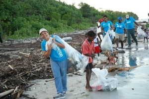 Sandals Foundation and residents clean up a beach in St. Ann. (Photo: Loop Jamaica)