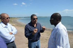 Minister of Tourism and Entertainment, Dr Wykeham McNeill (centre), discusses plans to upgrade the Old Harbour Bay Beach with Member of Parliament for South Western St Catherine, Everald Warmington (right), and Mayor of Spanish Town, Councillor Norman Scott.  (Photo: Jamaica Observer)
