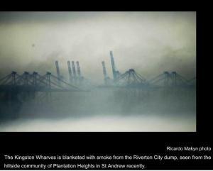 Kingston wharves blanketed in smoke. (Photo: Ricardo Makyn)
