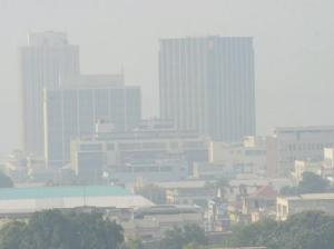 The New Kingston business center in a polluted haze a few days ago. Downtown Kingston is still smothered in smoke today.  (Photo: Gleaner)