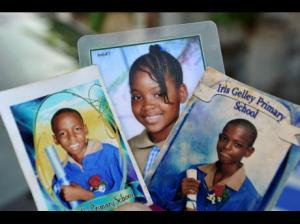 The three siblings who perished in a fire in Arnett Gardens. A relative has been charged with their murders. Neighbors heard nine-year-old Abigail's cries for help, but the fire was already too fierce.