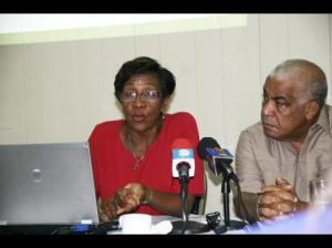 Robert Pickersgill, Minister of Water, Land, Environment and Climate Change pays keen attention as conservator of forests, Marilyn Headley speaks about the changes in Jamaica's forest coverage over the past 16 years. Occasion was a press conference hosted by the Forestry Department this week. (Photo: Christopher Serju/Gleaner)