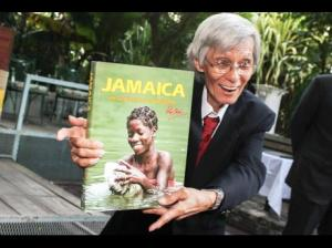 """Photographer Ray Chen with his latest publication, """"Jamaica: My 50 Years in Photography."""" (Photo: Brian McCalla/Gleaner)"""