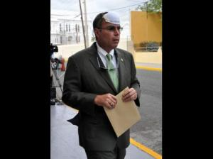 Jermaine Barnaby Opposition MP Daryl Vaz created a stir last Thurssday went he entered Parliament with a dust mask on his head in what he said was solidarity with the people of Kingston and St Catherine suffering with the smoke from the Riverton dump. (Photo: Jermaine Barnaby/Gleaner)