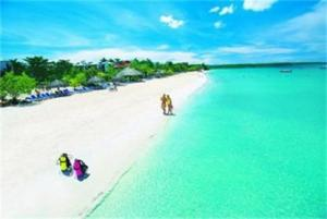 A beautifully photo-shopped photo of Negril from a tourist page. Where is the real, happy community-feel Negril we once loved?
