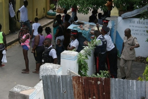 """The police in Bryden Street, Dunkirk, downtown after the murder of """"Flavor"""" on Thusday. (Photo: Loop Jamaica)"""