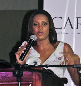 "Broadcast journalist Emily Shields (who has just started her talk show on RJR) speaking at the launch of the ""CARIMAC Times."" (My photo)"