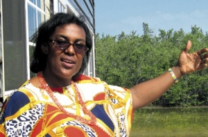 C-CAM's hard-working Executive Director Ingrid Parchment points to the surrounding mangroves at Salt River. (Photo: Kimone Thompson/Jamaica Observer)