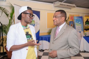 """Comedian Russhaine """"Dutty"""" Berry, ambassador for the Nuh Dutty Up Jamaica campaign, chats with Director of Tourism Paul Pennicook at JET's event. (Photo: Jamaica Environment Trust)"""