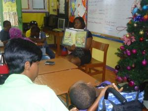 Christine Staple-Ebanks, NEF Founder & President reads for Grade 4 students at Liberty Academy on Wednesday December 3, International Day  for Persons with Disabilities. (Photo: Nathan Ebanks Foundation)