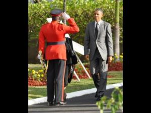Colonel Daniel Pryce salutes US President Barack Obama at National Heroes Park on Thursday. (Photo: Jermaine Barnaby/Gleaner)