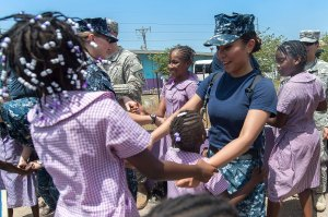 And there was dancing! Hospital Corpsman 3rd class Maria Reyes, assigned to the Military Sealift Command Hospital Ship USNS Comfort (T-AH 20) dances with children at the Rennock Lodge All Age School. (U.S. Navy photo by Mass Communication Specialist Seaman Kameren Guy Hodnett/Released)