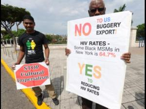 Daniel Thomas (left), president of the Love March Movement, and a supporter of the group on Knutsford Boulevard, Kingston today. (Photo: Ricardo Makyn/Gleaner)