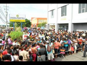 The desperate crowds outside the Passport Office yesterday. The whole affair was poorly planned and then completed mishandled. Surely the Government officials in charge could have foreseen a scene like this resulting from their incompetence. (Photo: Jermaine Barnaby/Gleaner)