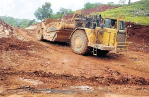 A tractor at work on the new access road being built in the Bryan's Castle area of St Ann. (Photo: Garfield Robinson/Jamaica Observer)