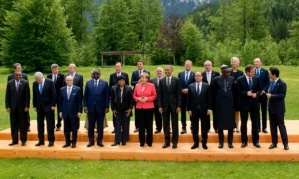 G7 leaders, including Angela Merkel (in pink jacket), and invitees line up for the traditional group photo at the end of the summit earlier this month. Photograph: Sven Hoppe/dpa/Corbis
