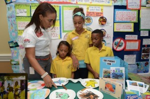 Students of Vista Preparatory School in St. Ann explain the importance of Parrot Fish to Andrea Stephenson of Total Jamaica. (Photo: JET)