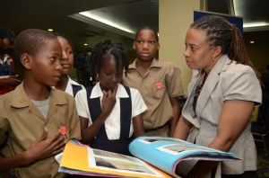President of the Press Association of Jamaica and guest speaker at the event Dionne Jackson Miller speaks to students of Sandy Bay Primary & Junior High School about their research on the medicinal uses of plants. (Photo: JET)