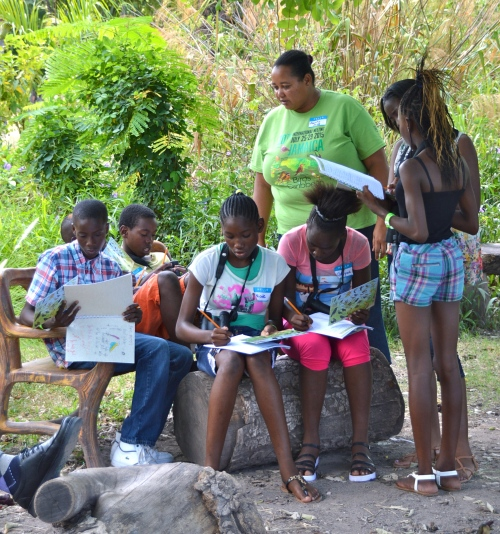 BirdSleuth teacher Ava Tomlinson gives directions to this group of trainee bird detectives in Hope Gardens. (Photo: Doris Gross/BirdsCaribbean)