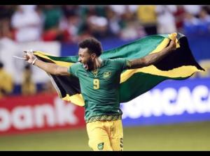 Jamaica's Giles Barnes celebrates after Jamaica defeated the United States 2-1 in a CONCACAF Gold Cup soccer semi-final. (Photo: AP)