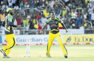 Andre Russell (right) and Chris Gayle celebrate a wicket during the Jamaica Tallawahs Hero Caribbean Premier League game against Barbados Tridents at Sabina Park yesterday. (PHOTO: BRYAN CUMMINGS/Jamaica Observer)