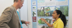 Susan Otuokon, Executive Director of the JCDT, explains the management of the Blue and John Crow Mountains National Park to a participant at a conference of the International Union for the Conservation of Nature (IUCN). (Photo: JCDT)