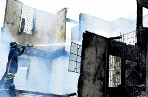 A firefighter working at the Wortley Home for Girls, operated by the Anglican Church and founded in 1918. Fortunately, no one was hurt in the fire. (Photo: Jamaica Observer)