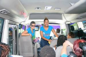 Felicia Won (standing, right) engages passengers on the bus. (Photo: JET/Facebook)