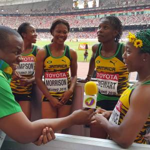 TVJ's Kayon Raynor interviews Sherone Simpson, Natasha Morrison,, Kerron Stewart and Shelly-Ann Fraser-Pryce after their 4x100 heat. (Photo: Facebook)