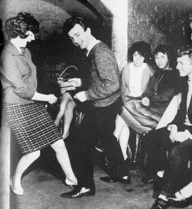 "Cilla dancing with her friend Gerry Marsden (of Gerry and the Pacemakers) in the Cavern Club in the early 1960s. Gerry had a mega-hit in 1963 with ""You'll Never Walk Alone."" Does that sound familiar, Liverpool Football Club fans? (Photo: Liverpool Echo)"