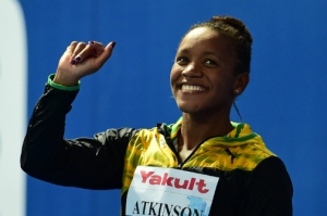 Alia Atkinson celebrates her silver medal during the podium ceremony for the women's 50m breaststroke at the FINA World Championships. (photo: AFP)