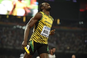 "Jamaica's Usain Bolt crosses the finish line to win for the Jamaican team the final of the men's 4x100 metres relay athletics event at the 2015 IAAF World Championships at the ""Bird's Nest"" National Stadium in Beijing on August 29, 2015. AFP PHOTO / OLIVIER MORIN"