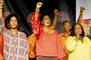 People's National Party candidate for Clarendon South Eastern Patricia Duncan Sutherland (centre) is flanked by her sister Senator Imani Duncan Price (left) and minister with responsibility for sports Natalie Neita Headley at Sunday's party conference on the grounds of the Old Hayes School. (Photo: Jamaica Observer)