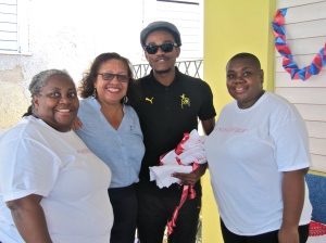 """Joy Crawford (far left) Programs Director and Patricia Watson (far right), Executive Director, Eve for Life, with Ruth Weller Jankee of World Learning and Sheldon Shepherd of No-Maddz at a """"Nuh Guh Deh"""" event. Eve works with teenage mothers, most living with HIV, and their children. (My photo)"""