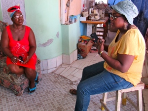 Paulette Coley (left) discussing community matters with Ingrid Parchment of C-CAM.