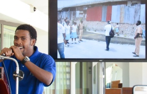 Jason Lindo sings about the Tourism Action Club's explorations in McGregor Gully (pictured on screen).