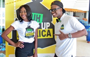 "Young comedians Bella Blair and Russhaine ""Dutty Berry"" Berry having fun with the ""Nuh Dutty Up Jamaica"" logo. (My photo)"