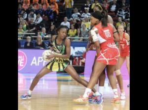 Jamaica's goal attack Shanice Beckford (left) collects the ball ahead of England Eboni Beckford-Chambers during their Newball World Cup match played at the Allphones Arena at Sydney Olympic Park yesterday. England won 54-50. (Photo by Collin Reid courtesy of PetroJam, Supreme Ventures, Courts and Scotiabank)