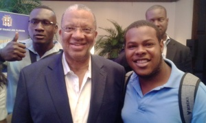Youth advocate Adrian Watson with Finance Minister Peter Phillips at an event.