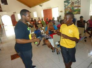 Adrian Watson (left) interacts with youth at