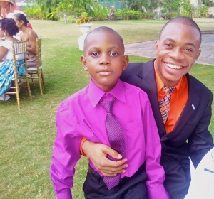 Radio reporter Rashawn Thompson and his rather serious young brother (aged six) at the tea party. (My photo)