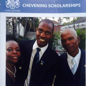 Framed: Chevening Scholar Jerome Cowans and his parents at the tea party. (Photo: Facebook)