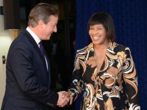 A handshake from Prime Minister Portia Simpson Miller; Mr. Cameron has probably already endured a few hugs by this time.