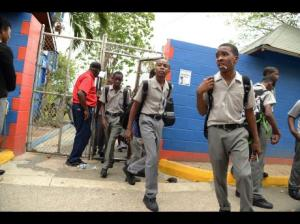 Clan Carthy High School students leaving school yesterday. (Photo: Rudolph Brown/Gleaner)