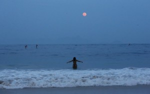 Not a spectacular super moon image, but atmospheric: Copacabana Beach in Rio de Janeiro, Brazil. (Photo by Mario Tama/Getty Images)