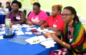 Bloggers in the making: Women participating in WMW Jamaica's PowHERhouse workshop actually drafted outlines of their first blog and wrote an opening paragraph. (My photo)